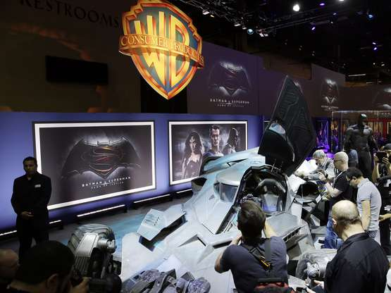 """IMAGE DISTRIBUTED FOR WARNER BROS. - Members of the media and fans gather as Warner Bros. Consumer Products exclusively unveils the Batmobile and select costumes from the highly anticipated film, """"Batman v Superman: Dawn of Justice"""" at Licensing Expo 2015 on Tuesday, June 9, 2015 in Las Vegas. (Photo by Isaac Brekken/Invision for Warner Bros./AP Images)"""