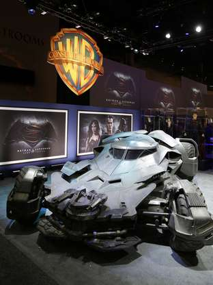 "IMAGE DISTRIBUTED FOR WARNER BROS. - Warner Bros. Consumer Products exclusively unveils the Batmobile and select costumes from the highly anticipated film, ""Batman v Superman: Dawn of Justice"" at Licensing Expo 2015 on Tuesday, June 9, 2015 in Las Vegas. (Photo by Isaac Brekken/Invision for Warner Bros./AP Images)"