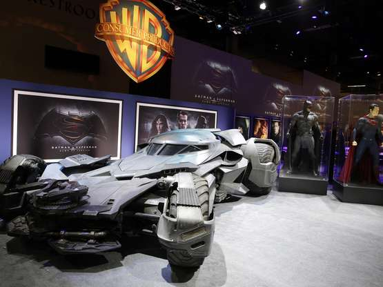"""IMAGE DISTRIBUTED FOR WARNER BROS. - Warner Bros. Consumer Products exclusively unveils the Batmobile and select costumes from the highly anticipated film, """"Batman v Superman: Dawn of Justice"""" at Licensing Expo 2015 on Tuesday, June 9, 2015 in Las Vegas. (Photo by Isaac Brekken/Invision for Warner Bros./AP Images)"""